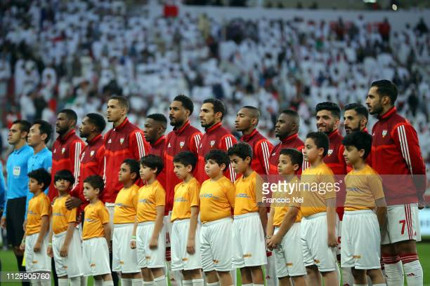 The UAE team listens to the national anthems prior to the AFC Asian Cup semi final match between Qatar and United Arab Emirates at Mohammed Bin Zayed...
