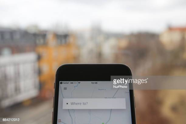 The Uber app is seen on an iPhone on 16 March 2017