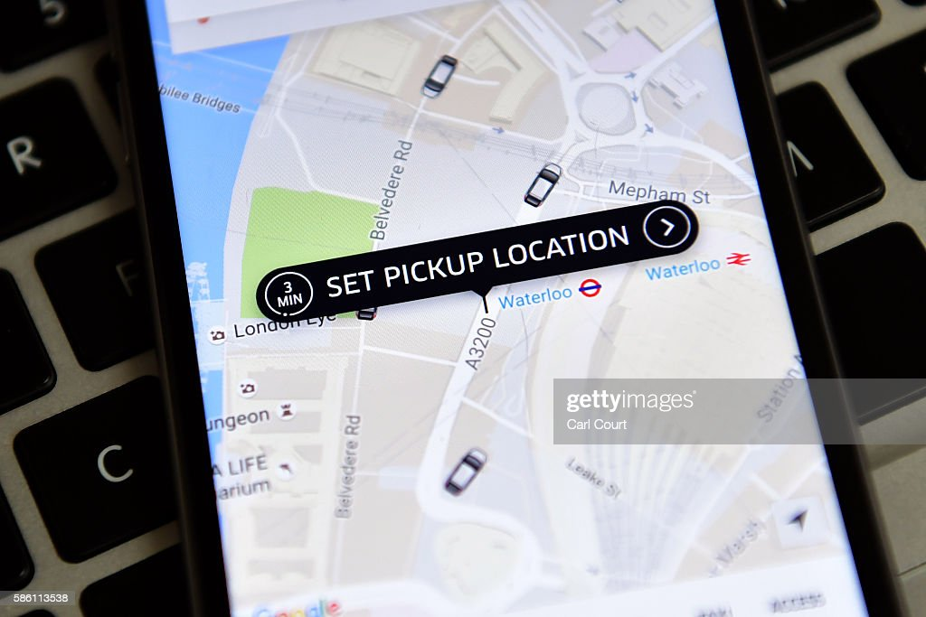 The Uber home page is displayed on an iPhone on August 3, 2016 in London, England.