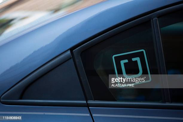 The Uber logo is seen on a car in Washington, DC, on July 9, 2019.