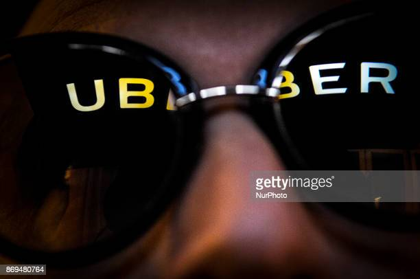The Uber logo is seen reflected in a pair of sunglasses on November 2 2017
