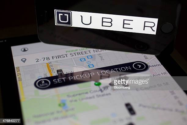 The Uber Technologies Inc application and logo are displayed on an Apple Inc iPhone 5s and iPad Air in this arranged photograph in Washington DC US...