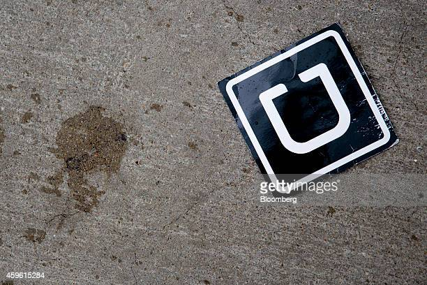 The Uber Technologies Inc logo is seen on the ground at Ronald Reagan National Airport in Washington DC US on Wednesday Nov 26 2014 Uber Technologies...