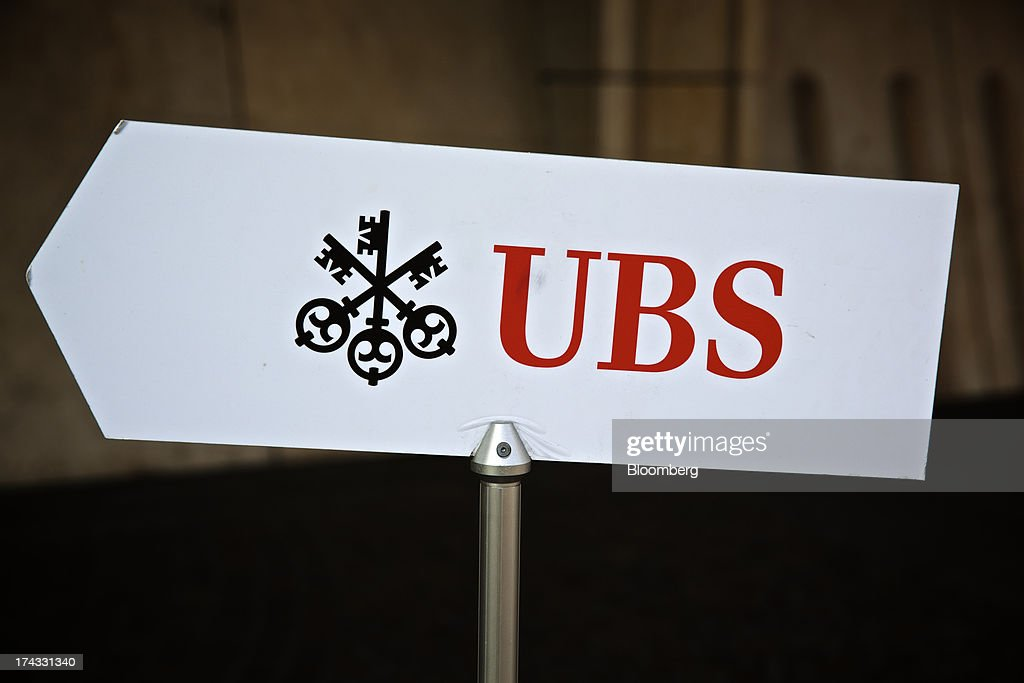 The UBS AG logo sits on a sign outside the bank's offices in Basel, Switzerland, on Tuesday, July 23, 2013. Europe's biggest banks, which more than doubled their highest-quality capital to $1 trillion since 2007 to meet tougher rules, may have further to go as regulators scrutinize how lenders judge the riskiness of their assets. Photographer: Gianluca Colla/Bloomberg via Getty Images