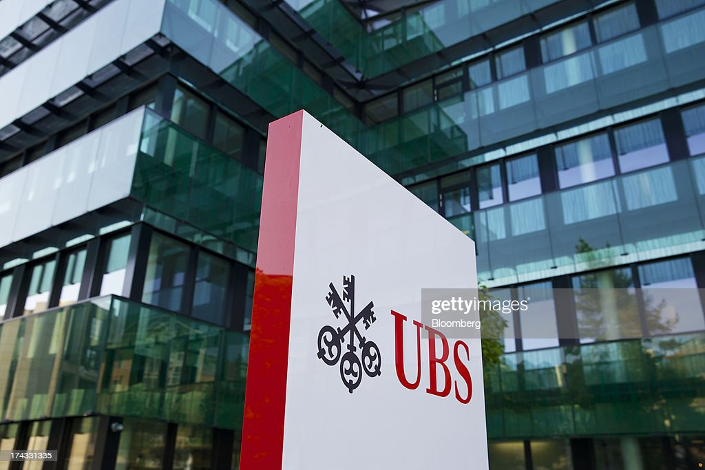 The UBS AG logo stands outside the bank's offices in Basel, Switzerland, on Tuesday, July 23, 2013. Europe's biggest banks, which more than doubled their highest-quality capital to $1 trillion since 2007 to meet tougher rules, may have further to go as regulators scrutinize how lenders judge the riskiness of their assets. Photographer: Gianluca Colla/Bloomberg via Getty Images