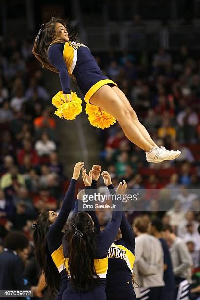 The UC Irvine Anteaters cheerleaders perform during a timeout in the first half against the Louisville Cardinals during the second round of the 2015...