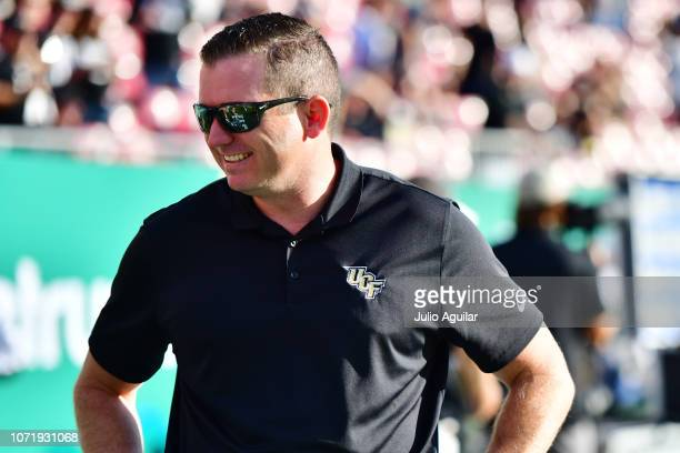 The UCF Knights Athletic director Danny White stands on the sidelines during warm-up before a game against the South Florida Bulls at Raymond James...