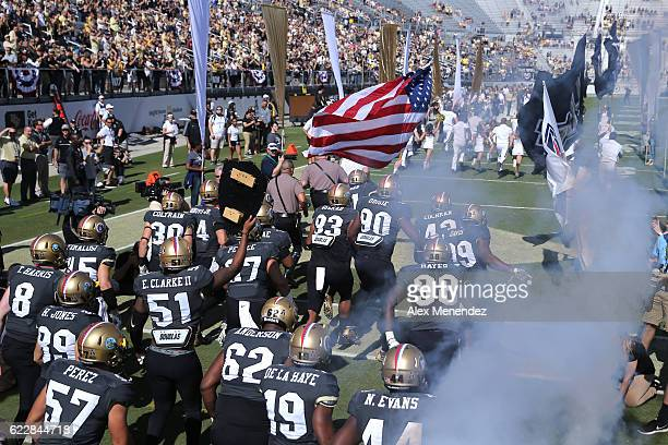 The UCF Knights carry the United States flag as they enter the field during a NCAA football game at Bright House Networks Stadium on November 12 2016...