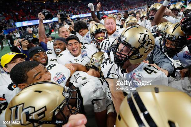 The UCF Knights celebrate defeating the Auburn Tigers 3427 to win the ChickfilA Peach Bowl at MercedesBenz Stadium on January 1 2018 in Atlanta...