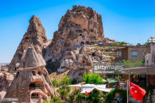 the uchisar castle - turchia stock photos and pictures