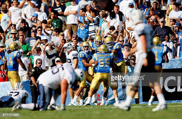 The UCLA Bruins 11 Dennis Keyes 55 Korey Bosworth and 42 Chad Moline celebrate a touch down while BYU is dejected in the foreground 55 Jeff Rhea...