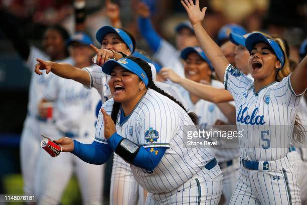 The UCLA Bruins celebrate after a home run by Aaliyah Jordan against the Oklahoma Sooners during the Division I Women's Softball Championship held at...