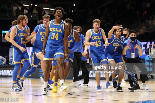 The UCLA Bruins celebrate their overtime victory over the Alabama Crimson Tide in the Sweet Sixteen round of the 2021 NCAA Division I Men's...