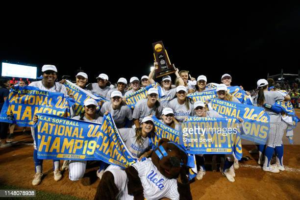The UCLA Bruins celebrate their victory against the Oklahoma Sooners during the Division I Women's Softball Championship held at ASA Hall of Fame...