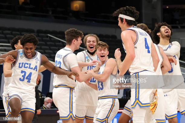 The UCLA Bruins celebrate their win over the Abilene Christian Wildcats in the second round game of the 2021 NCAA Men's Basketball Tournament at...