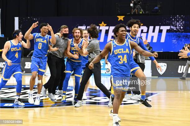 The UCLA Bruins celebrate their win over the Michigan Wolverines in the Elite Eight round of the 2021 NCAA Division I Men's Basketball Tournament...