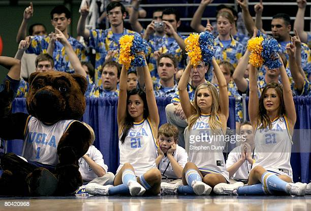 The UCLA Bruins cheerleaders and the mascot cheer on their team during the West Regional Sweet 16 game against Western Kentucky Hilltoppers at the US...