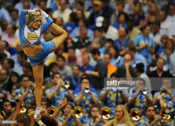 The UCLA Bruins cheerleaders perform as their team takes on the Memphis Tigers in the first half during the National Semifinal game of the NCAA Men's...
