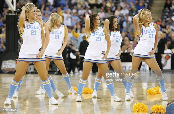 The UCLA Bruins cheerleaders perform as they take on the LSU Tigers during the semifinal game of the NCAA Men's Final Four on April 1 2006 at the RCA...