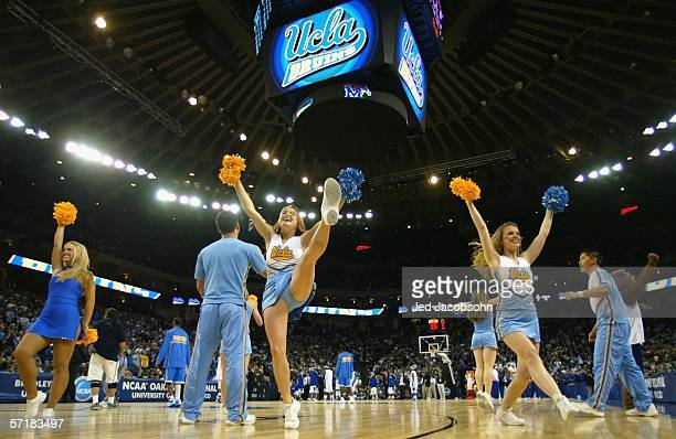 The UCLA Bruins cheerleaders perform during a break from the third round game of the NCAA Division I Men's Basketball Tournament against the Memphis...