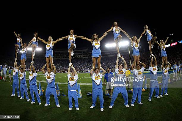 The UCLA Bruins cheerleaders perform during the game against the Nebraska Cornhuskers at the Rose Bowl on September 8 2012 in Pasadena California...