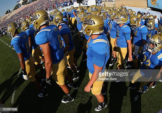 The UCLA Bruins come out of tunnel to take the field for the game with the Nebraska Cornhuskers at the Rose Bowl on September 8 2012 in Pasadena...