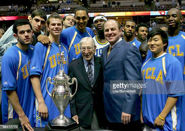 The UCLA Bruins stand with John Wooden after defeating the Nevada Wolf Pack 6756 during the 12th Annual John R Wooden Classic on December 10 2005 at...