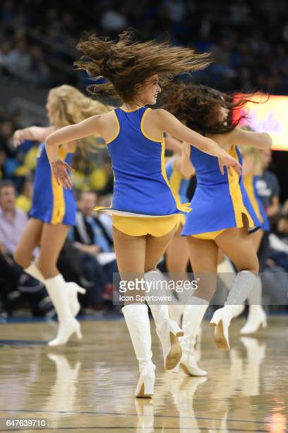 The UCLA Cheerleaders perform during a college basketball game between the Washington Huskies and the UCLA Bruins on March 1 at Pauley Pavilion in...