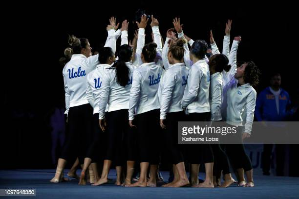 The UCLA women's gymnastics team cheers ahead of a PAC12 meet against Arizona State at Pauley Pavilion on January 21 2019 in Los Angeles California