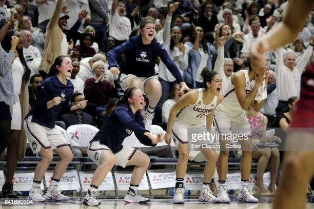 The UConn bench including Tierney Lawlor Molly Bent Kyla Irwin Kia Nurse and Napheesa Collier of the Connecticut Huskies erupts as they celebrate a...