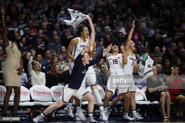 The UConn bench react to a basket from left Tierney Lawlor Napheesa Collier Katie Lou Samuelson Gabby Williams and Kia Nurse of the Connecticut...