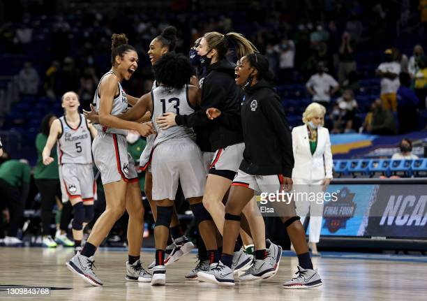 The UConn Huskies celebrate the win over the Baylor Lady Bears after the Elite Eight round of the NCAA Women's Basketball Tournament at the Alamodome...