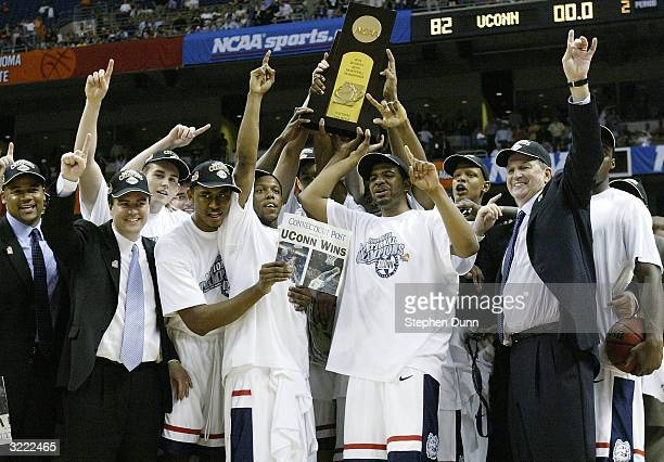 The UConn Huskies celebrate with the trophy after defeating the Georgia Tech Yellow Jackets 82-73 during the National Championship game of the NCAA...