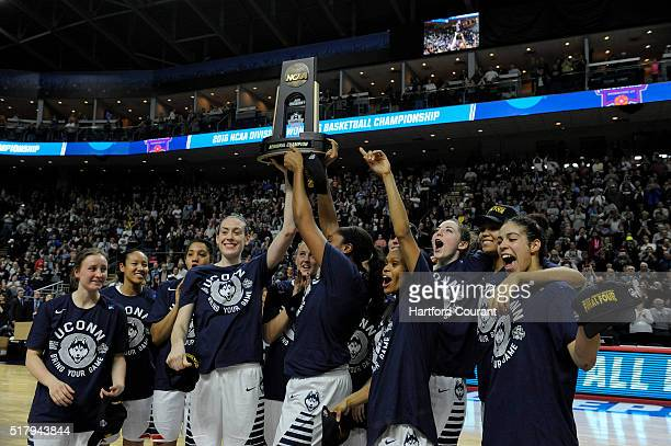 The UConn women hoist the East Regional championship trophy after a 8665 victory over Texas in their Elite Eight game on Monday March 28 at the...