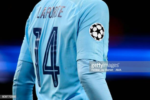 The UEFA Champions League emblem is seen on the arm of Aymeric Laporte of Manchester City during the UEFA Champions League Round of 16 Second Leg...