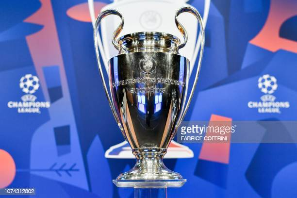 The UEFA Champions League football cup is displayed prior to the draw for the round of 16 of the UEFA Champions League football tournament at the...