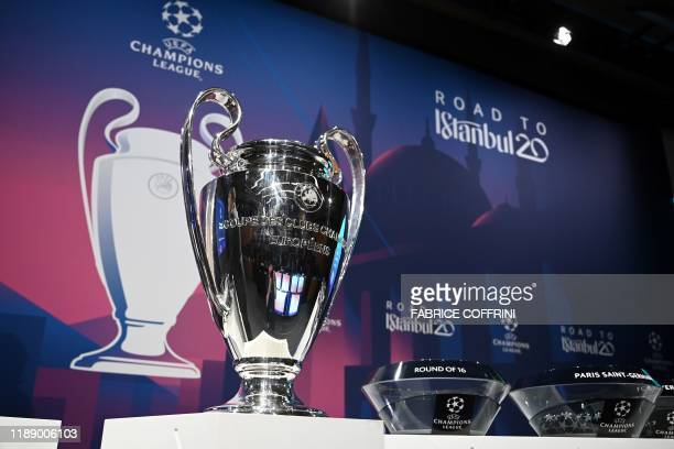 The UEFA Champions League football trophy is pictured prior to the cup's round of 16 draw ceremony on December 16 2019 in Nyon