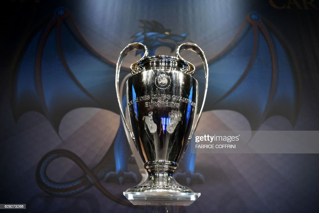 The UEFA Champions League Trophy Is Displayed Before Round Of 16 Draw