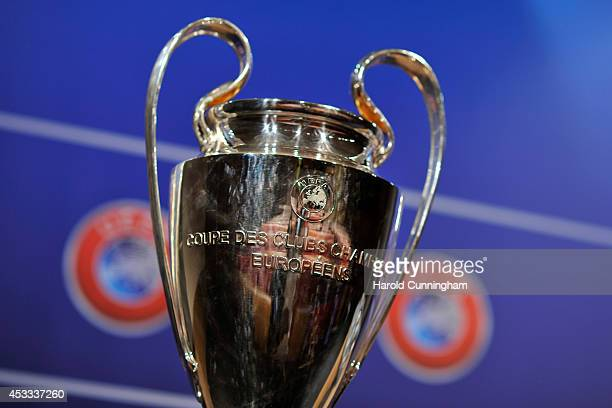 The UEFA Champions League trophy is displayed during the 2014/15 UEFA Champions League Play-off round draw at the UEFA headquarters, The House of...