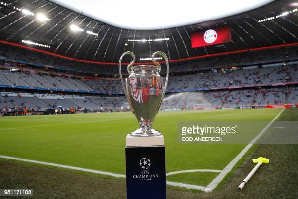 The UEFA Champions League trophy is on display prior to the semi-final first-leg football match FC Bayern Munich v Real Madrid CF in Munich, southern...