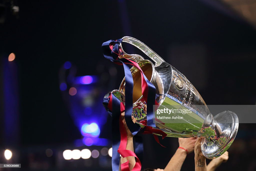 The UEFA Champions League Trophy With Blue And Red Ribbons Of FC Barcelona