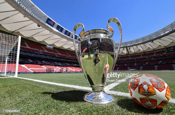 The UEFA Champions League winners trophy is pictured with the official match ball next to the pitch prior to the UEFA Champions League Final between...