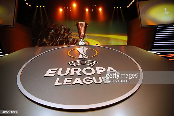 The UEFA Cup trophy and the logo are pictured during the draw for the UEFA Europa League football group stage 2015/16 on August 28 2015 in Monaco AFP...
