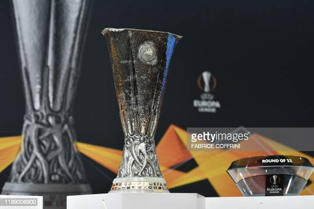 The UEFA Europa League football cup trophy is pictured before its round of 32 draw ceremony on December 16 2019 in Nyon