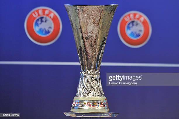 The UEFA Europa League trophy is displayed during the 2014/15 UEFA Europa League Playoff round draw at the UEFA headquarters The House of European...