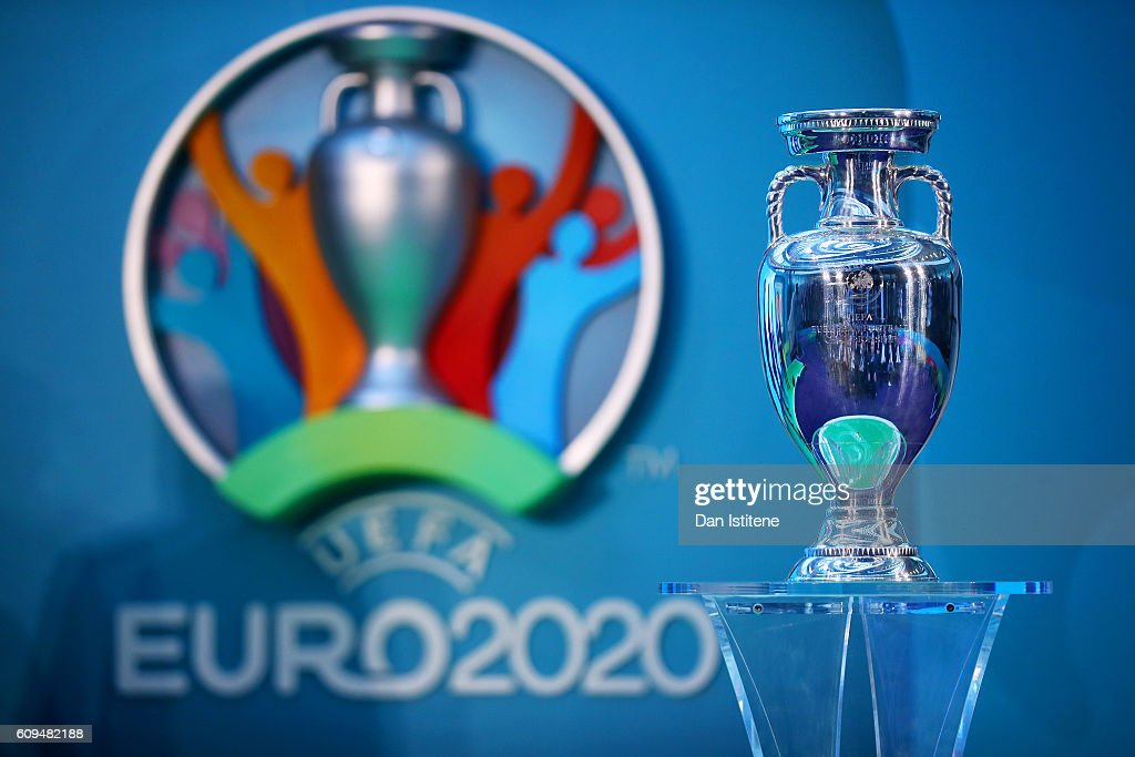 The UEFA European Championship trophy is displayed next to the logo for the UEFA EURO 2020 tournament during the UEFA EURO 2020 launch event for London at City Hall on September 21, 2016 in London, England.