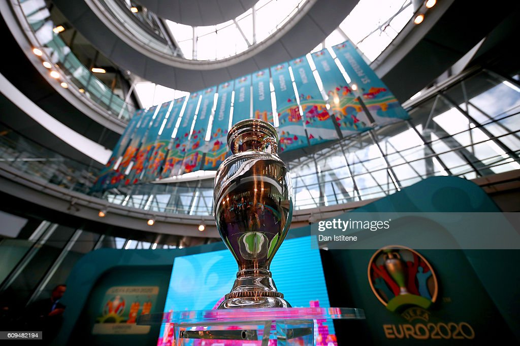 The UEFA European Championship trophy is displayed next to the logo for the UEFA EURO 2020 tournament and the individual city logos during the UEFA EURO 2020 launch event for London at City Hall on September 21, 2016 in London, England.