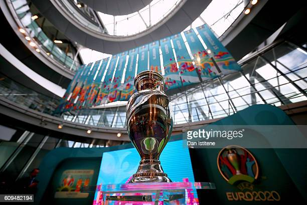 The UEFA European Championship trophy is displayed next to the logo for the UEFA EURO 2020 tournament and the individual city logos during the UEFA...