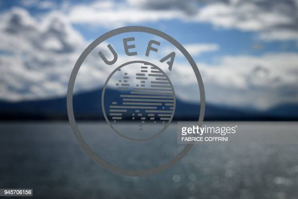 The UEFA logo is seen during the draw for the semifinals round of the UEFA Champions League football tournament at the UEFA headquarters in Nyon on...