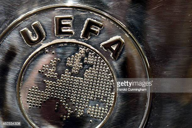 The UEFA logo is seen on the UEFA Champions League trophy as it is prepared for the UEFA 2014/15 Champions League third qualifying rounds draw at the...